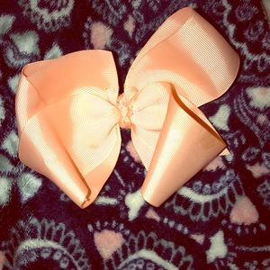 Coral pink bow for a little girl